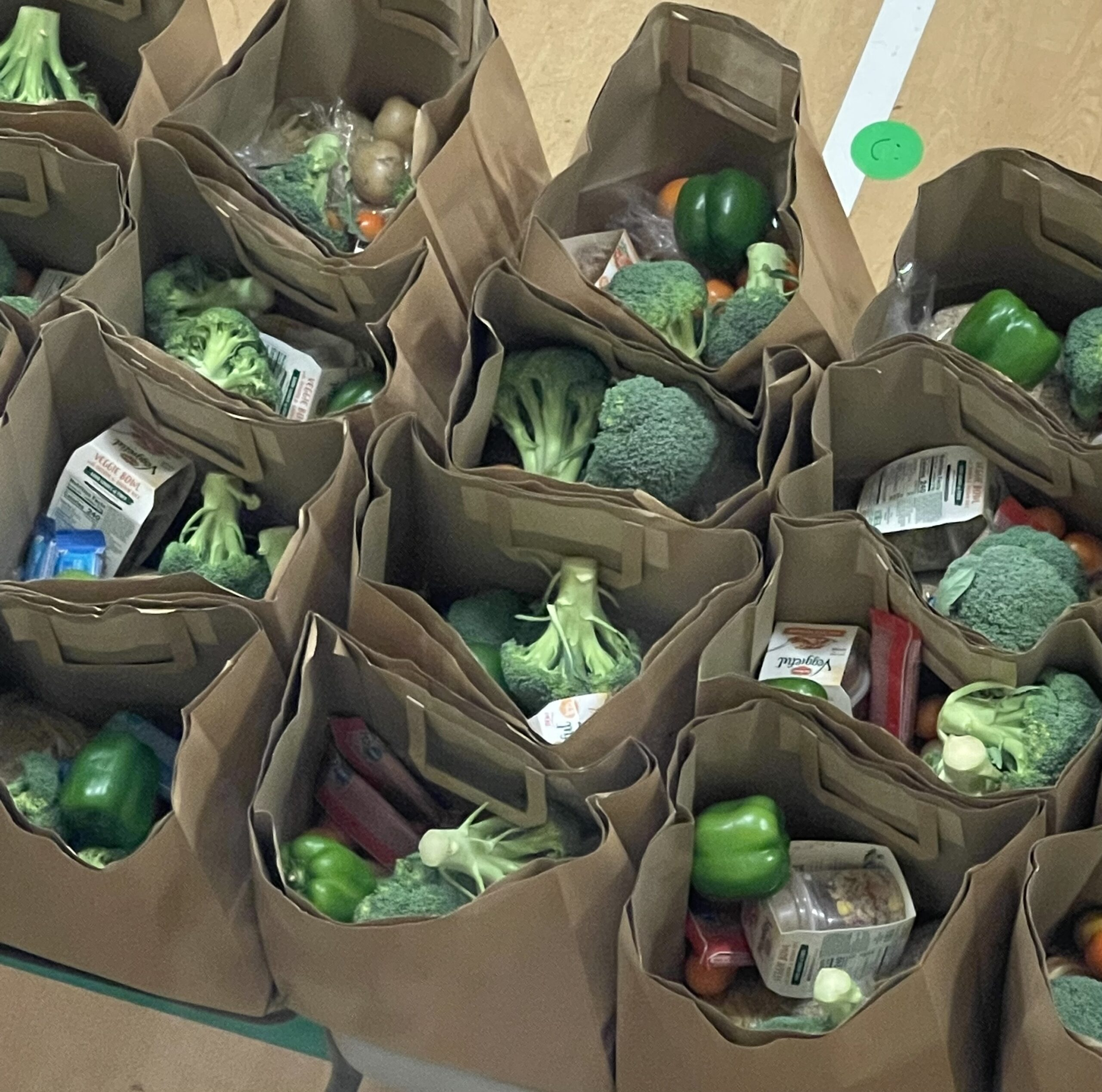 Grocery sacks of food prepared for giving out to those in need.
